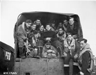 2 crews from 433 Sqdrn Dec 2 1944 being driven to their planes for an op